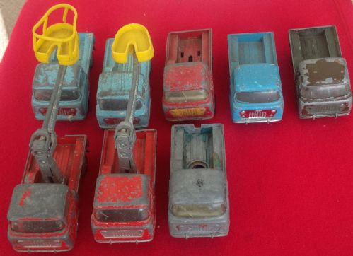 Collection of Eight Corgi Toys 409 Jeep FC-150 and GS14 Tower Wagons